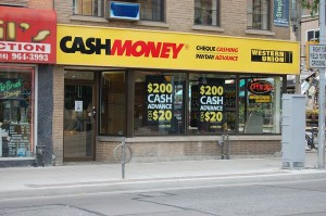 Payday Loan Companies Are Making Billions Preying On The Misery Of The Poor - Photo by Vinceesq