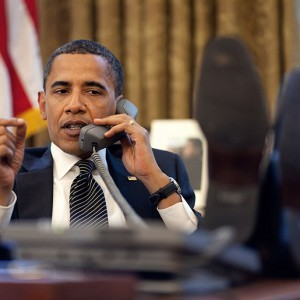 Barack Obama On The Phone In The Oval Office