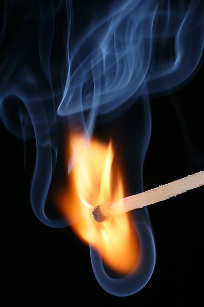 Lighting A Match - Photo by Sebastian Ritter